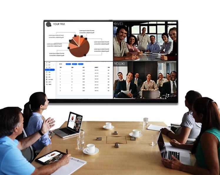 桌子上的电脑萤幕的一群人  中度可信度描述已自动生成